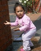 Zelda Wynn; IT'S WET DAD; Taken in New Lynn a little girl found the water fascinating