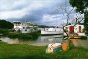 Stuart Weekes;We're never far from the ocean.;Houseboats in Putiki Bay.